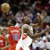 Houston Rockets\' Patrick Patterson, right, loses the ball as Los Angeles Clippers\' Eric Bledsoe (12) defends during the first quarter of an NBA basketball game, Tuesday, Jan. 15, 2013, in Houston. (AP Photo/David J. Phillip)
