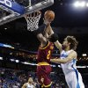 Cleveland Cavaliers guard Kyrie Irving (2) goes to the basket in front of New Orleans Hornets center Robin Lopez in the first half of an NBA basketball game in New Orleans, Sunday, March 31, 2013. The Hornets won 112-92. (AP Photo/Gerald Herbert)