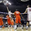 Oklahoma\'s Cade Davis (34) shoots the ball over the top of Syracuse\'s Arinze Onuaku (21) during the first half of the NCAA Men\'s Basketball Regional at the FedEx Forum on Friday, March 27, 2009, in Memphis, Tenn. PHOTO BY CHRIS LANDSBERGER, THE OKLAHOMAN