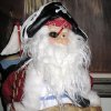 AHOY MATEYS...Santa in the Meredith home held the treasure map and wore his eye patch and pirate\'s hat. (Photo by Helen Ford Wallace).