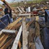 Angie Dean helps clean the damage at the home of Tom Chronister that was destroyed by Tuesday\'s tornado north of El Reno, Wednesday, May 25, 2011. Photo by Chris Landsberger, The Oklahoman