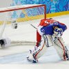 Photo - Czech Republic goaltender Alexander Salak looks down at the ice after the team's 5-2 loss to the United States in the men's quarterfinal hockey game in Shayba Arena at the 2014 Winter Olympics, Wednesday, Feb. 19, 2014, in Sochi, Russia. (AP Photo/Matt Slocum)