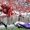 Photo -   Wisconsin quarterback Danny O'Brien breaks away from Northern Iowa's Jake Farley during the first half of an NCAA college football game Saturday, Sept. 1, 2012, in Madison, Wis. (AP Photo/Morry Gash)