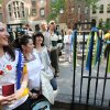 Oksana Golab, her sister Olesya Semenyak and mother, Halyna Smenyak, all of Clifton, N.J., watch people pose for pictures outside the Ukrainian Consulate in New York Sunday Mary 25, 2014. (AP Photo/The Record of Bergen County, Kevin R. Wexler) ONLINE OUT; MAGS OUT; TV OUT; INTERNET OUT; NO ARCHIVING; MANDATORY CREDIT Ukrainians from the tri-state area and beyond went to the Ukrainian Consulate in New York City on Sunday to vote for their country\'s new president. Twenty-one voters left on a bus from St. Nicholas Ukrainian Catholic Church in Passaic. Ukraine has had an interim president since their revolution this winter. Sunday May 25, 2014. STAFF PHOTO BY; KEVIN R. WEXLER (AP Photo/Northjersey.com)