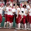 Sooner Erica Sampson is greeted at home plate after hitting a home run with two base runners on as the University of Oklahoma (OU) Sooners play the Oklahoma State University Cowgirls in NCAA college softball at Marita Hines Field on Wednesday, April 25, 2012, in Norman, Okla. Photo by Steve Sisney, The Oklahoman