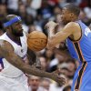 Clippers' forward Reggie Evans, left, battles the Thunder's Russell Westbrook for a loose ball during Oklahoma City's 112-100 loss on Monday night. AP photo