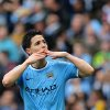 Photo - Manchester City's Samir Nasri blows a kiss as he celebrates his goal during the English Premier League soccer match between Manchester City and West Ham at the Etihad Stadium in Manchester, England, Sunday May 11, 2014.  (AP Photo/Jon Super)