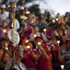 People hold up candles and images of Venezuela\'s President Hugo Chavez during candlelight vigil to pray for his health as he remains in a hospital undergoing cancer treatment, in Caracas, Venezuela, Friday, Feb. 22, 2013. The government has not given details about the treatment Chavez is undergoing, and hasn\'t identified the type or exact location of the tumors that have been removed from his pelvic region. (AP Photo/Ariana Cubillos)