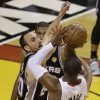 Miami Heat\'s Dwyane Wade (3) shoots against San Antonio Spurs\' Manu Ginobili (20) of Argentina during the first half in Game 7 of the NBA basketball championships, Thursday, June 20, 2013, in Miami. (AP Photo/Wilfredo Lee)