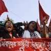 Bangladeshi garment workers shout slogans as they participate in a protest to mourn the death of the victims of a fire in a garment factory in Dhaka, Bangladesh, Friday, Nov. 30, 2012. Hundreds of garment workers protested Friday outside the Bangladeshi factory where 112 people were killed by the fire, demanding compensation for their lost salaries. The banner reads: