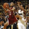 Photo - UNIVERSITY OF OKLAHOMA, OU: Oklahoma's Omar Leary, center, shoots as he drives between Missouri's Laurence Bowers, left, and Marcus Denmon, right, during the first half of an NCAA college basketball game Wednesday, March 4, 2009, in Columbia, Mo. (AP Photo/L.G. Patterson) ORG XMIT: MOLG104