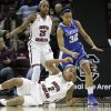 Kentucky\'s Kastine Evans (32) goes for the loose ball as South Carolina\'s Ieasia Walker (2) falls to the court and Tiffany Mitchell (25) watches during the first half of their NCAA college basketball game, Thursday, Jan. 24, 2013, in Columbia, S.C. (AP Photo/Mary Ann Chastain)