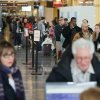 Travelers wait for over an hour in a long line for customer service after many flights are canceled on a snowy Presidents Day at Washington\'s Reagan National Airport in Monday, Feb. 15, 2016. (AP Photo/Andrew Harnik)