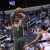 Milwaukee Bucks guard Brandon Jennings (3) shoots against Washington Wizards guard A.J. Price (12) during the first half of an NBA basketball game on Friday, Nov. 9, 2012, in Washington. (AP Photo/Nick Wass)