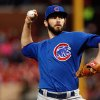 Photo - Chicago Cubs starting pitcher Jake Arrieta throws during the first inning of a baseball game against the St. Louis Cardinals on Tuesday, May 13, 2014, in St. Louis. (AP Photo/Scott Kane)