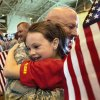 Madison Frazier, 7, hugs her grandfather, Chief Warrant Officer-3 Benny Milam from McLoud. Frazier and a younger sister came from San Antonio to greet their grandfather when he returned home. When 84 Oklahoma Army National Guard troops marched into the hangar at the Air National Guard base in southwest Oklahoma City Saturday morning, April 7, 2012, about 350 people, mostly family and friends, gave them a rousing and enthusiastic welcome. Their homecoming celebration marked the final return of soldiers with the 45th who had been deployed to Iraq and Afghanistan. Photo by Jim Beckel, The Oklahoman