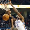 Oklahoma City\'s Serge Ibaka slams the ball in front of Toronto\'s James Johnson during the second half of their NBA basketball game at the OKC Arena in downtown Oklahoma City on Sunday, March 20, 2011. The Raptors beat the Thunder 95-93. Photo by John Clanton, The Oklahoman