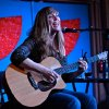 Photo -  Okemah red dirt singer-songwriter Susan Herndon plays a 2013 show at the Blue Door. Photo by M. Tim Blake.