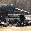 Photo - Investigators work at the scene of the fatal shooting of Alaska State Trooper Sergeant Patrick