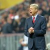 Photo - Arsenal head coach Arsene Wenger gestures during the Champions League round of the last 16 second leg soccer match between FC Bayern Munich and Arsenal FC in Munich, Germany, on Tuesday, March 11. 2014. (AP Photo/Kerstin Joensson)