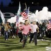 Photo -  Students lead the Edmond Santa Fe Wolves as they take the field before a high school football game between Edmond Santa Fe and Norman at Wantland Stadium in Edmond. Photo by Nate Billings, The Oklahoman Archives   NATE BILLINGS -