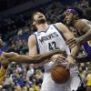 Photo - Minnesota Timberwolves' Kevin Love, center, loses the ball as he is fouled by Los Angeles Lakers' Nick Young, left, as Young and Jordan Hill defend during the first quarter of an NBA basketball game, Tuesday, Feb. 4, 2014, in Minneapolis. (AP Photo/Jim Mone)