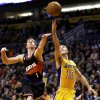 Los Angeles Lakers\' Steve Nash (10) shoots next tp Phoenix Suns\' Goran Dragic, of Slovenia, during the first half on an NBA basketball game, Wednesday, Jan. 30, 2013, in Phoenix. (AP Photo/Matt York)