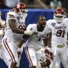 Oklahoma\'s Eric Striker (19) celebrates his sack of Alabama\'s AJ McCarron (10) and Oklahoma\'s Chuka Ndulue (98) and Charles Tapper (91) look on during the NCAA football BCS Sugar Bowl game between the University of Oklahoma Sooners (OU) and the University of Alabama Crimson Tide (UA) at the Superdome in New Orleans, La., Thursday, Jan. 2, 2014. .Photo by Sarah Phipps, The Oklahoman