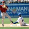 Photo - Los Angeles Dodgers' Scott Van Slyke (33) is out at second base on fielder's choice as Arizona Diamondbacks' Aaron Hill throws to first base in the eighth inning of a baseball game on Sunday, June 15, 2014, in Los Angeles. (AP Photo/Jayne Kamin-Oncea)