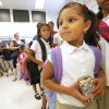 Kindergarten student Jenniver Martinez, age 5, holding her milk while going through the breakfast line before classes start for the day at Adams Elementary in Oklahoma City Wednesday, Aug. 1, 2012. Wednesday was the first day of classes in the Oklahoma City Public School District. Photo by Paul B. Southerland, The Oklahoman