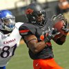 Oklahoma State\'s Brodrick Brown (19) intercepts a pass in front of Kansas\' Marquis Jackson (81) during a college football game between the Oklahoma State University Cowboys (OSU) and the University of Kansas Jayhawks (KU) at Boone Pickens Stadium in Stillwater, Okla., Saturday, Oct. 8, 2011 Photo by Steve Sisney, The Oklahoman ORG XMIT: KOD