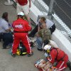 Emergency personnel attend to injured spectators in front of the grandstands after Kyle Larson\'s car hit the safety wall and fence along the front stretch on the final lap of the NASCAR Nationwide Series auto race at Daytona International Speedway in Daytona Beach, Fla., Saturday, Feb. 23, 2013. (AP Photo/Phelan M. Ebenhack)