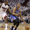 Oklahoma City\'s Russell Westbrook (0) goes past Miami\'s Mario Chalmers (15) during Game 3 of the NBA Finals between the Oklahoma City Thunder and the Miami Heat at American Airlines Arena, Sunday, June 17, 2012. Photo by Bryan Terry, The Oklahoman