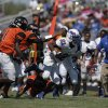 Milwood\'s Janari Glover (21) runs the ball during a high school football game between Douglass and Millwood in Oklahoma City, Saturday, Sept. 8, 2012. Photo by Garett Fisbeck, The Oklahoman