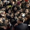 Actor Leonardo DiCaprio is mobbed by fans during the premiere of his new film