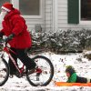 Sam Getz, dressed like Santa Claus, pulls his brother Jacob through the snow on Portland Terrace in Webster Groves, near St. Louis, Mo., on Friday, Dec. 6, 2013. Though schools were open in on Friday, Sam\'s mother Jennifer Getz allowed her boys to stay home. (AP Photo/St. Louis Post-Dispatch, Rober Cohen) EDWARDSVILLE INTELLIGENCER OUT; THE ALTON TELEGRAPH OUT