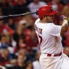 Photo - St. Louis Cardinals' Jhonny Peralta follows through on an RBI single during the sixth inning of a baseball game against the Chicago Cubs on Tuesday, May 13, 2014, in St. Louis. (AP Photo/Scott Kane)