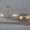 Traffic makes its way down U.S. Highway 64 in Guymon, Okla. on Dec. 19, 2011 during a heavy snow storm. A Blizzard Warning has been posted for the region with up to a foot of snow expected. (AP Photo/She Guymon Daily Herald, Shawn Yorks). ORG XMIT: OKGUY102