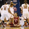 Photo - Oklahoma's Nicole Griffin (4) sits on the court after being called for a foul during a Big 12 women's basketball tournament game between the OU Sooners and Texas at the Chesapeake Energy Arena in Oklahoma City, Saturday, March 8, 2014. UT won, 82-72. Photo by Nate Billings, The Oklahoman