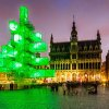 An abstract light installation replaces the traditional Christmas tree at the Grand Place in Brussels, Saturday Dec. 1, 2012. Traditionally, a 20m (65ft) pine tree from the forests of the Ardennes decorates the city\'s central square, the Grand Place. This year, it has been replaced with a 25m (82ft) construction. (AP Photo/Geert Vanden Wijngaert)