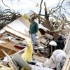 Jimmy Wyatt stands on tornado damage at a friend\'s home who died in the storm in Lone Grove, Okla, Thursday, Feb, 12, 2009. PHOTO BY SARAH PHIPPS, THE OKLAHOMAN