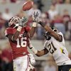Oklahoma\'s Jaz Reynolds (16) catches a pass in front of Missouri\'s Trey Hobson (21) during their game Saturday. Photo by Steve Sisney, The Oklahoman