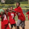 YOUTH KICKBALL TOURNAMENT / CHILD / CHILDREN / KIDS / XAZAVIER WARE: Three players from the McKinley Park Shooters converge near the second base path to catch the ball for an out. From left, Xazavier (cq) Ware, Marcus Dockins and Caleb Todd. About 100 youth participated in a kickball tournament at Hall of Fame Stadium Wednesday, June 26, 2013. Eight teams represented a variety of recreation centers from different parts of the city. Pilot Center won the tournament which was sponsored by the OKC Parks and Recreation Department in conjunction with the Police Athletic League. Photo by Jim Beckel, The Oklahoman.