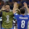 Photo - Italy's goalkeeper Gianluigi Buffon, left, celebrates with Claudio Marchisio after the group D World Cup soccer match between England and Italy at the Arena da Amazonia in Manaus, Brazil, Saturday, June 14, 2014. Italy won the match 2-1.   (AP Photo/Matt Dunham)
