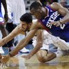Photo -   Philadelphia 76ers small forward Thaddeus Young (21) battles for a loose ball with New Orleans Hornets point guard Greivis Vasquez (21) in the first half of an NBA basketball game in New Orleans, Wednesday, Nov. 7, 2012. (AP Photo/Gerald Herbert)