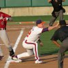 Photo - Umpire David Brown, right, watches as South Carolina's Connor Bright, left, tags the bag for a single before Clemson first baseman Jon McGibbon catches the ball during an NCAA college baseball game on Sunday, March 2, 2014 in Clemson, S.C. (AP Photo/Anderson Independent-Mail, Mark Crammer) GREENVILLE NEWS OUT  SENECA JOURNAL OUT
