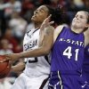 Danielle Gant is fouled by Kari Kincaid (41) during the 2009 Big 12 Women\'s Basketball Championship game between Kansas State Wildcats and the Texas A&M Aggies in the Cox Convention Center in Oklahoma City, Oklahoma, on Friday, March 13, 2009. PHOTO BY STEVE SISNEY, THE OKLAHOMAN