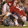 Oklahoma\'s Landry Jones (12) is sacked by Kansas State\'s Javonta Boyd (99) during the college football game between the University of Oklahoma Sooners (OU) and the Kansas State University Wildcats (KSU) at the Gaylord Family-Memorial Stadium on Saturday, Sept. 22, 2012, in Norman, Okla. Photo by Chris Landsberger, The Oklahoman
