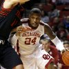 Oklahoma\'s Romero Osby (24) goes under Texas Tech\'s Dejan Kravic (11) during an NCAA college basketball game between the University of Oklahoma and Texas Tech University at Lloyd Noble Center in Norman, Okla., Wednesday, Jan. 16, 2013. Photo by Bryan Terry, The Oklahoman