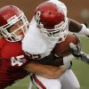 Caleb Gastelum (45) tackles Roy Finch (22) after a pass completion during the University of Oklahoma (OU) football team\'s annual Red and White Game at Gaylord Family/Oklahoma Memorial Stadium on Saturday, April 14, 2012, in Norman, Okla. Photo by Steve Sisney, The Oklahoman